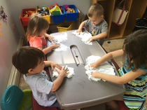 4 Kids playing with white gooey substance