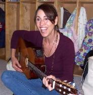 Elaine Kessler playing the guitar