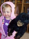 Little girl with gorilla puppet